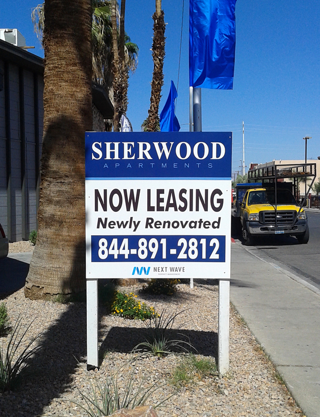 Sherwood Apts Now Leasing Sign